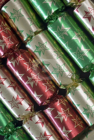 Christmas crackers stock photo, An arrangement of colourful metallic christmas crackers by Stephen Gibson
