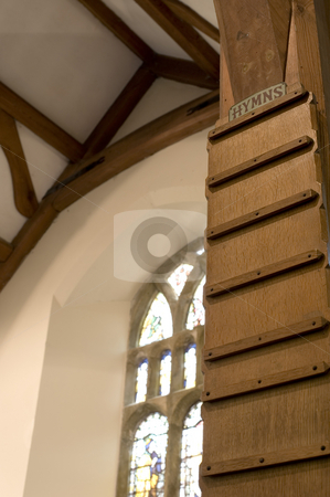 Hymn board stock photo, A traditional wooden hymn board from a small village church by Stephen Gibson