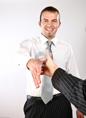 Nice Meeting You! stock photo, Photo Of A Young Enthusiastic Man Shaking Hands by Nick Fingerhut
