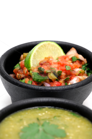 Mexican Salsa stock photo, Bowls of spicy homemade salsa topped with fresh lime both tomato and salsa verde are included by Lynn Bendickson