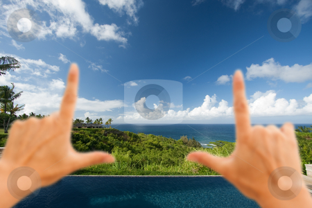 Hands Framing Breathtaking Hawaiian Ocean View Deck and Pool stock photo, Hands Framing Breathtaking Hawaiian Ocean View Deck and Pool with Deep Blue Sky by Andy Dean