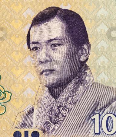 Jigme Singye Wangchuck stock photo, Jigme Singye Wangchuck (1955-) on 10 Ngultrum 2006 Banknote from Bhutan. King of Bhutan during 1972-2006. by Georgios Kollidas