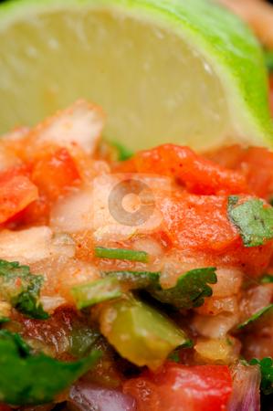 Salsa Extreme Close-up stock photo, Close-up of spicy homemade salsa topped with fresh lime. Ingredients include tomato cilantro onion garlic