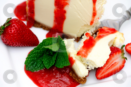 Cheesecake With Strawberry stock photo, Slice of cheesecake with fresh strawberries and and a bright red strawberry sauce dripping over the sides on the dessert. by Lynn Bendickson