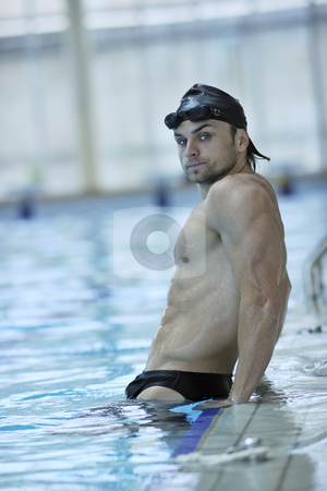 Swim pool stock photo, Young healthy with muscular body man swim on swimming pool and representing healthy and recreation concept by Benis Arapovic