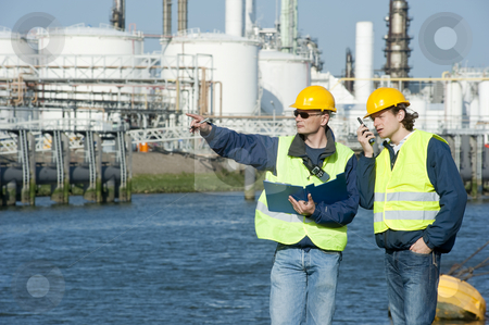 Petrochemical Engineers stock photo, Two petrochemical engineers discussing a project outdoors by Corepics VOF