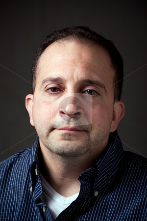 Middle Aged Man stock photo, Portrait of a middle aged man in his upper thirties with a serious or concerned expression on his face. by Todd Arena