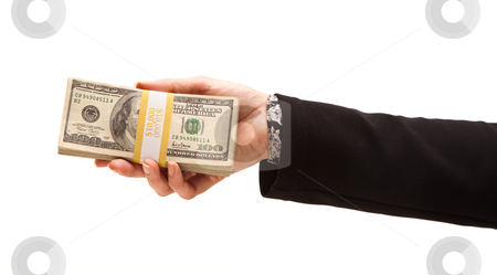 Woman Handing Over Hundreds of Dollars stock photo, Woman Handing Over Hundreds of Dollars Isolated on a White Background. by Andy Dean