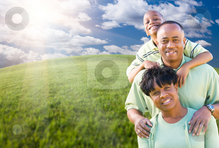 Family Over Clouds, Sky and Grass Field stock photo, Happy African American Family Over Clouds, Sky and Arched Horizon of Grass Field. by Andy Dean