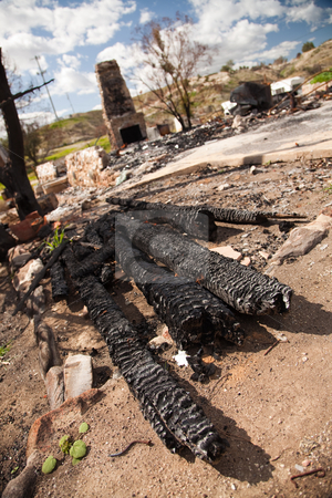 Remains of a Burned Down House stock photo, Remains of a Burned Down House with Brick Fireplace Standing. by Andy Dean