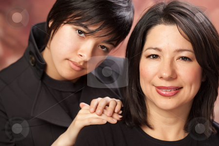 Attractive Multiethnic Mother and Daughters Portrait stock photo, Attractive Multiethnic Mother and Daughters Studio Portrait. by Andy Dean