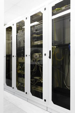 Racks with network equipment stock photo, Racks with network equipment in technology telehouse room by Artush