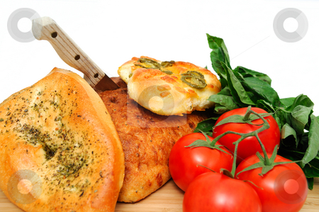 Vegetables Herbs And Bread stock photo, A loaf of old style unsliced bread with  Focaccia topped with Italian herbs and jalapeno with cheddar cheese. by Lynn Bendickson