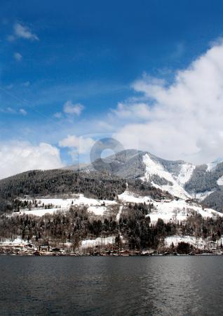 Cloudscape over Alpine lake stock photo, Scenic view of cloudscape over Alpine lake and mountains. by Martin Crowdy