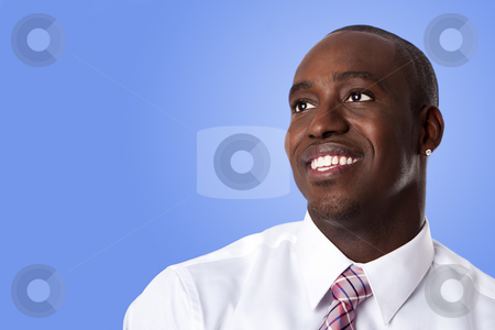 Happy African American business man stock photo, Face of handsome happy African American corporate business man smiling, wearing white shirt and pink with stripes necktie on a blue sky-like background. by Paul Hakimata