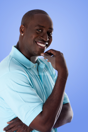 Happy African American business man stock photo, Handsome happy African American corporate business man smiling, wearing blue polo shirt and hand on chin, isolated. by Paul Hakimata