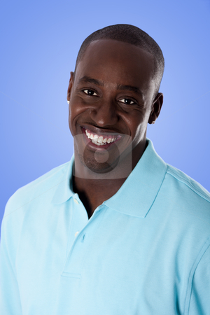 Happy African American business man stock photo, Face of handsome happy African American corporate business man smiling, wearing blue polo shirt, isolated. by Paul Hakimata