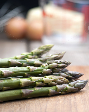 Fresh Asparagus stock photo, Fresh Asparagus Laid Out On A Wooden Chopping Board, With Ingredients For Hollandaise Sauce In The Background by Karen Appleyard