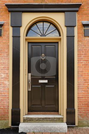 Elegant Front Door In A Brick Building Stock Photo