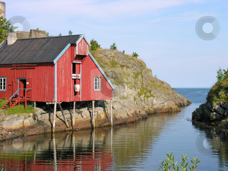 House over a river stock photo, Palafitte house over a river in Lofoten, Norway by Alberto Rigamonti