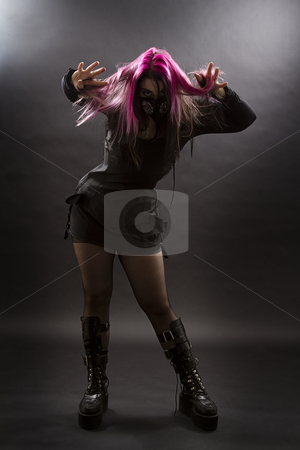 Psycho goth girl stock photo, Maniacal looking goth girl with pink hair and body piercing pulling her hair by Yann Poirier