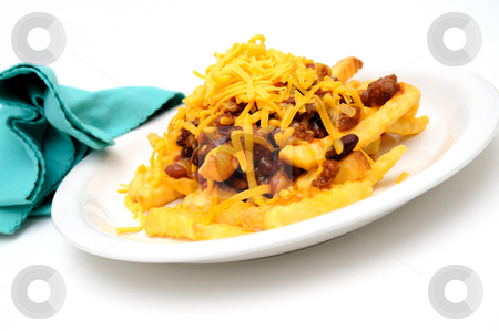 Chili Cheese Fries stock photo, Melting cheddar cheese over the top of french fries covered in spicy chili with meat and beans by Lynn Bendickson