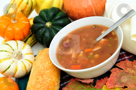 Fall Vegetables And Warm Soup stock photo, A bowl of warm veggie soup with seasonal Autumn vegetables and colorful fall leaves by Lynn Bendickson