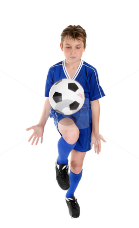 Boy soccer skills stock photo, A boy using a soccer ball skills practice.  Ball has some motion.  White background. by Leah-Anne Thompson