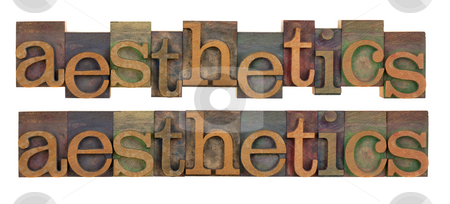 Aesthetics stock photo, The word of aesthetics in vintage wood letterpress type, stained by color ink, isolated on white, two layouts by Marek Uliasz