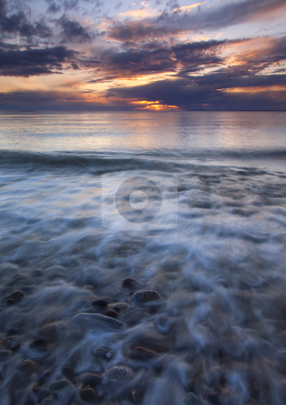 Water Over Sand and Stone stock photo, Ebbing Tides flow over sand and stone as the sun sets over the San Juan Islands of Washington by Mike Dawson