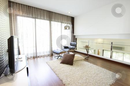 Living room stock photo, Interior of a modern living room by Adrin Shamsudin