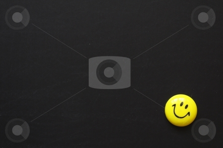 Smiley and copyspace stock photo, Yellow smiley or smilie on black chalkboard with copyspace for a text message by Gunnar Pippel