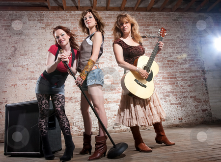 Female musicians stock photo, All girl trio performing in stylish clothing by Scott Griessel