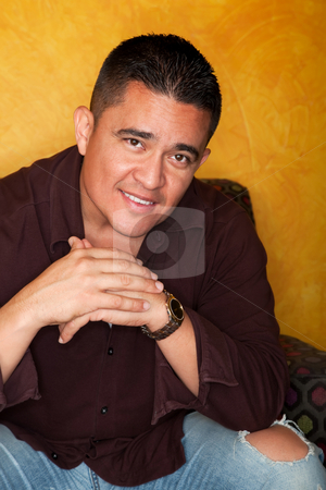 Hispanic Man  stock photo, Handsome Hispanic Man Seated in Colorful Chair by Scott Griessel
