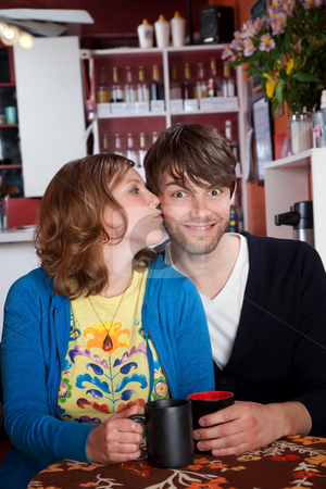 Happy couple stock photo, Happy young couple drinking coffee at a cafe by Scott Griessel