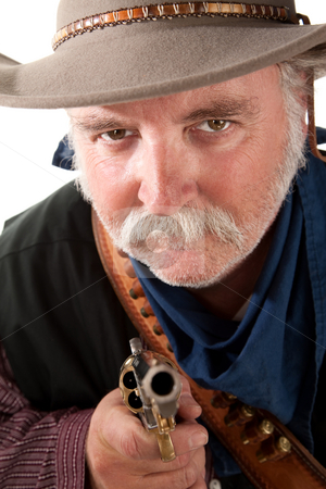Mean looking cowboy stock photo, Mean looking cowboy pointing pisto towards camera by Scott Griessel