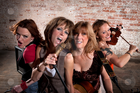 Female musicians stock photo, Stylish all girl pop or country band by Scott Griessel