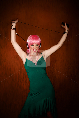 Disco Woman with Pink Hair stock photo, Disco dancing woman in green dress and pink hair by Scott Griessel
