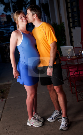 Pregnant woman and husband stock photo, Pregnant woman and husband in fitness attire on the street by Scott Griessel