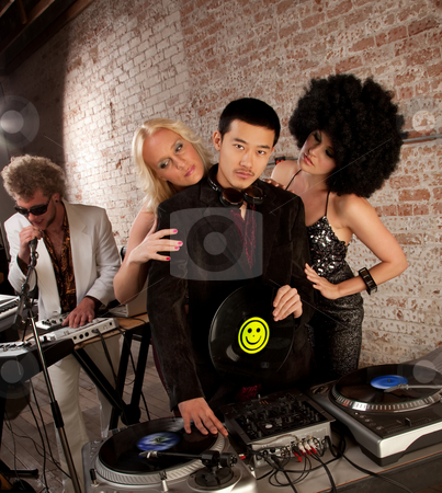 Handsome Asian DJ stock photo, Handsome Asian DJ surrounded by admiring fans by Scott Griessel