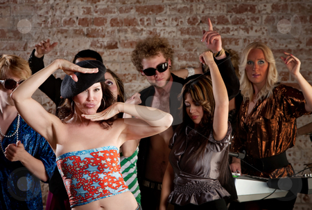 Lady in a beret stock photo, Lady in a beret dancing at a 1970s Disco Music Party by Scott Griessel