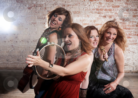 Female musicians stock photo, All-girl band performing in stylish clothing by Scott Griessel