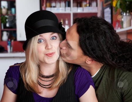 Caucasian and Native American couple stock photo, Caucasian and Native American couple kissing at a cafe by Scott Griessel