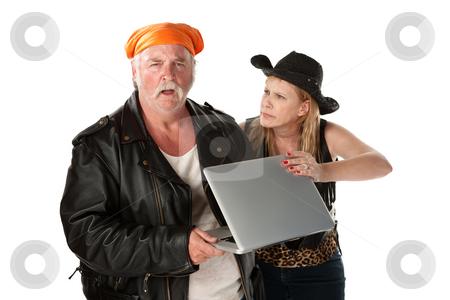 Mature biker couple arguing about a computer stock photo, Mature biker couple arguing about a computer by Scott Griessel