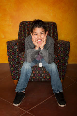 Hispanic Boy  stock photo, Handsome Young Hispanic Seated in Colorful  Chair by Scott Griessel