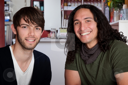 Handsome men stock photo, Two handsome young men together in a cafe by Scott Griessel
