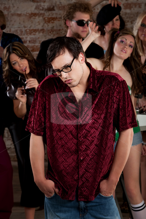 Shy guy stock photo, Nerdy loner at a 1970s Disco Music Party by Scott Griessel