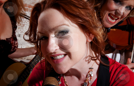 Female musicians stock photo, All girl band performing with redhead singer by Scott Griessel
