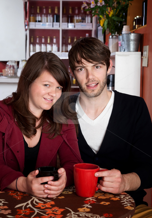 Happy young couple stock photo, Happy young couple drinking coffee at a cafe by Scott Griessel