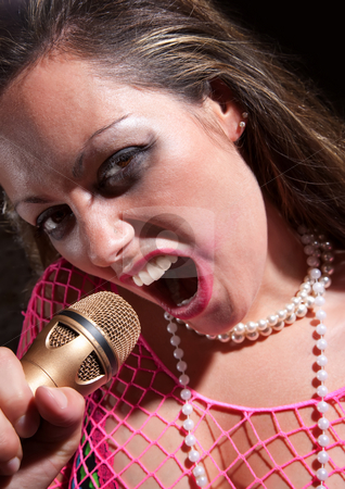 Punk Rock Girl stock photo, Brunette punk rocker girl with a microphone by Scott Griessel